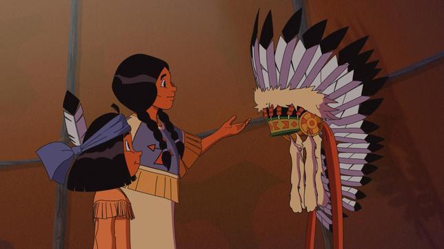 Schimmernde Zöpfe zeigt ihrem Sohn Yakari den Häuptlingsschmuck.