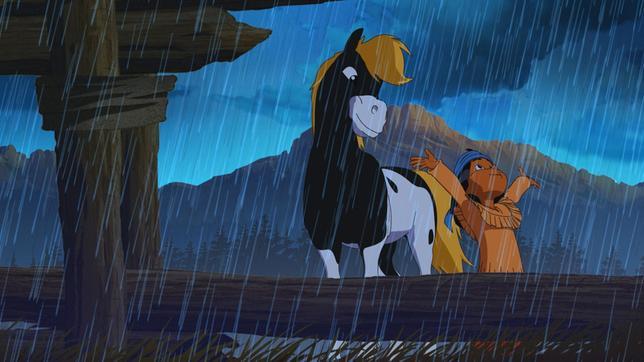 Yakari und sein Pony Kleiner Donner genießen den Regen.